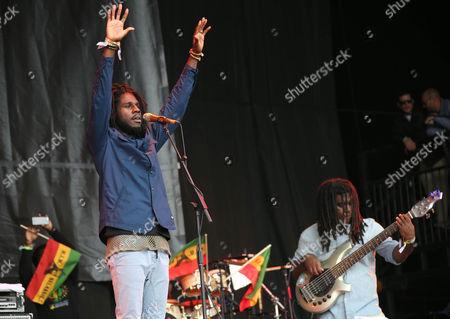 Jamaican reggae artist Jamar McNaughton Jr, left, popularly known as Chronixx, performs at Glastonbury Music Festival on at Worthy Farm, Glastonbury, England