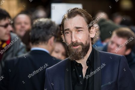 Actor Joseph Mawle poses for photographers upon arrival at the Empire Film Awards in London
