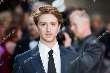Luke Newberry poses for photographers upon arrival at the Empire Film Awards in London