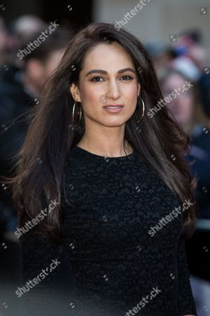 Asli Bayram poses for photographers upon arrival at the Empire Film Awards in London