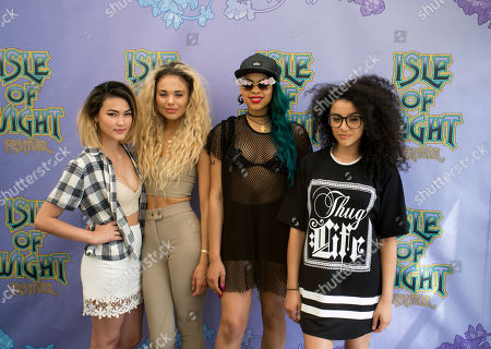 Asami Zdrenka, Jess Plummer, Amira McCarthy and Shereen Cutkelvin from 'Neon Jungle' band pose backstage for photographers at the Isle of Wight Festival in Newport on the Isle of Wight on . Thousands of people are to attend the three day event with headliners, Biffy Clyro, Calvin Harris, Red Hot Chilli Peppers and Kings of Leon