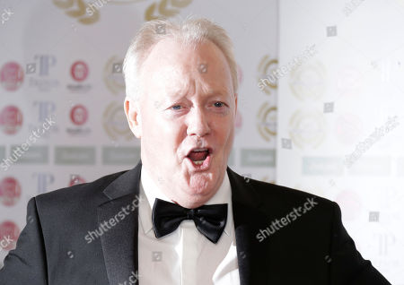 Keith Chegwin poses for photographers upon arrival for the National Film Awards in west London, Tuesday, 31 March, 2015
