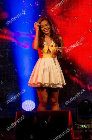 The singer of one of Britain's Got Talent finalist's -Luminites, Steph Edwards, performs on stage during the 2013 National Poppy Appeal Launch, on behalf of the Royal British Legion, at RAF Notholt in west London