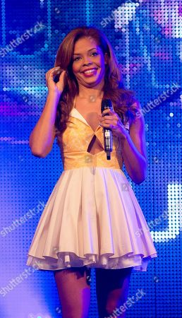 Stock Image of The singer of one of Britain's Got Talent finalist's -Luminites, Steph Edwards, performs on stage during the 2013 National Poppy Appeal Launch, on behalf of the Royal British Legion, at RAF Notholt in west London