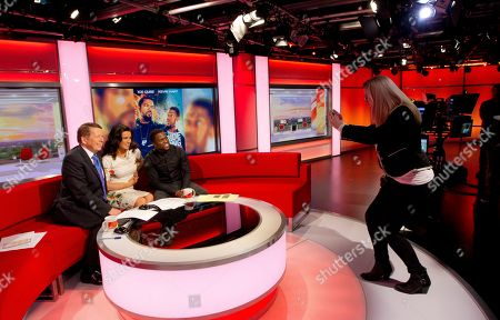 Ride Along actor and comedian Kevin Hart, right, has his photograph taken with BBC Breakfast presenters Susannah Reid and Bill Turnbull, left, after appearing on the morning show at Media City in Manchester