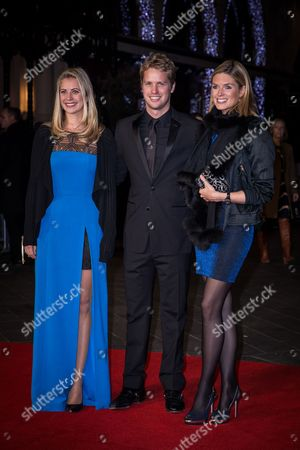 Holly Branson, Sam Branson and Isabella Calthorpe pose for photographers upon arrival at the premiere of the film 'Steve Jobs', as part of the London film festival in London