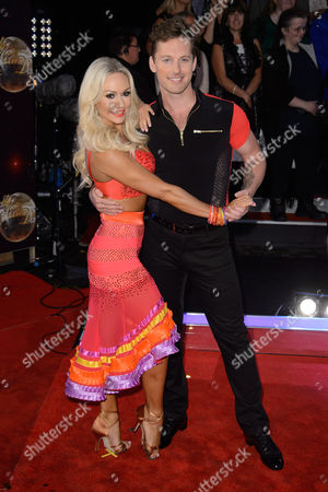 Kristina Rihanoff and Tristan MacManus pose for photographers at the Strictly Come Dancing 2015 launch event at Elstree Film Studios, London