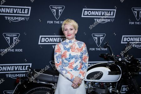 Lucy Speed poses for photographers upon arrival at the Triumph Motorcycle Launch Party in London