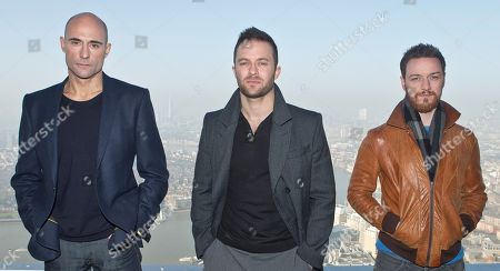Mark Strong and Eran Creevy British actors James McAvoy, right, Mark Strong, left, and Director Eran Creevy pose for photographs on top of Canary Wharf for the photo call of the film, Welcome To The Punch in east London