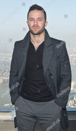 Director Eran Creevy poses for photographs on top of Canary Wharf for the photo call of the film, Welcome To The Punch in east London