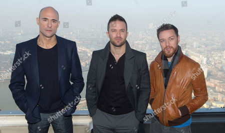 British actors James McAvoy, right, Mark Strong, left, and Director Eran Creevy pose for photographs on top of Canary Wharf for the photo call of the film, Welcome To The Punch in east London