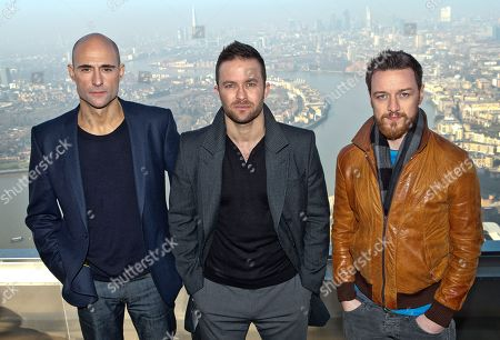British actors James McAvoy, right, Mark Strong, left, and director Eran Creevy pose for photographers on top of Canary Wharf, London, for the photo call of the film, Welcome To The Punch