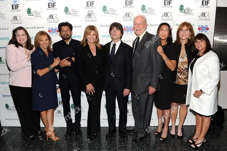 "SU2C co-founder Kathleen Lobb, left, SU2C co-founder Katie Couric, author Dr. Siddhartha Mukherjee, SU2C co-founder Lisa Paulsen, producer Ken Burns, SU2C Chairperson of Scientific Advisory Board, Dr. Phillip Sharp, SU2C president Sung Poblete, SU2C co-founder Rusty Robertson and SU2C co-founder Sue Schwartz attend the ""CANCER: The Emperor of All Maladies"" television launch event hosted by Stand Up To Cancer (SU2C) and WETA at the Museum of Modern Art on in New York"