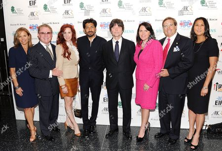 """Stock Picture of SU2C co-founder Katie Couric, left, CTCA's Richard Stephenson, Dr. Stacie Macari, Dr. Siddhartha Mukherjee and producer Ken Burns, Annie Stephenson Holsonback, Bill Hostetler and SU2C president Sung Poblete attend the """"CANCER: The Emperor of All Maladies"""" television launch event hosted by Stand Up To Cancer (SU2C) and WETA at the Museum of Modern Art on in New York"""