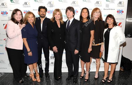 "SU2C co-founder Kathleen Lobb, left, SU2C co-founder Katie Couric, author Dr. Siddhartha Mukherjee, SU2C co-founder Lisa Paulsen, producer Ken Burns, SU2C president Sung Poblete, SU2C co-founder Rusty Robertson and SU2C co-founder Sue Schwartz attend the ""CANCER: The Emperor of All Maladies"" television launch event hosted by Stand Up To Cancer (SU2C) and WETA at the Museum of Modern Art on in New York"