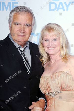 John Thomas McCook, at left, and his wife,Laurette Spang arrives at the CBS Daytime Emmy After Party at the Beverly Hilton Hotel on in Beverly Hills, Calif