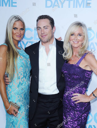 Jac McGraw, at center, his wife, Erica Dahm,at left, and her mother, Donita Dahm, arrive at the CBS Daytime Emmy After Party at the Beverly Hilton Hotel on in Beverly Hills, Calif