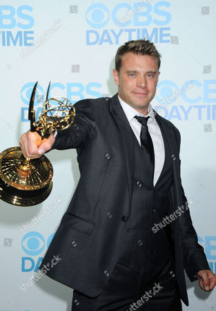 Billy Miller arrives at The CBS Daytime Emmy Awards Afterparty at the Aqua Star Pool, Beverly Hilton,, in Beverly Hills, CA