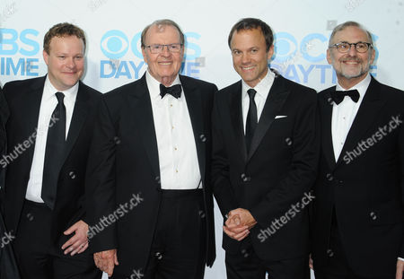 Chris Licht, from left, Charles Osgood, David Rhodes, and Rand Morrison arrives at The CBS Daytime Emmy Awards Afterparty at the Aqua Star Pool, Beverly Hilton,, in Beverly Hills, CA