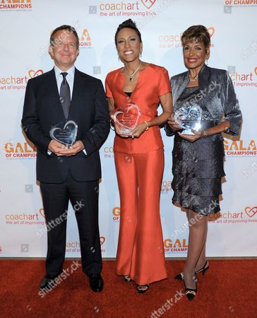 Jeremy Zimmer, left, and Robin Roberts, Sally-Ann Roberts arrive at the CoachArt 2013 Gala of Champions at the Beverly Hilton Hotel on in Beverly Hills, Calif