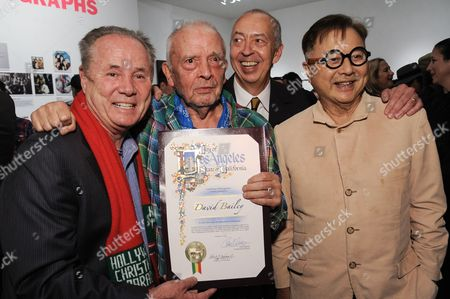 """From left, Los Angeles City Council Member Tom LaBonge, David Bailey, Benedikt Taschen and Michael Chow attend David Bailey's """"It's Just a Shot Away: The Rolling Stones In Photographs"""" Opening Reception, in Los Angeles"""
