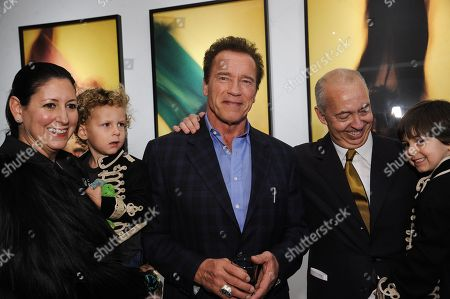 "Stock Photo of From left, Lauren Taschen, Arnold Schwarzenegger, and Benedikt Taschen attend David Bailey's ""It's Just a Shot Away: The Rolling Stones In Photographs"" Opening Reception, in Los Angeles"