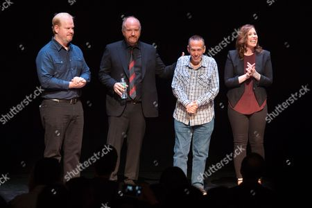 Comedians Jim Gaffigan, from left, Louis CK, Gilbert Gottfried, and Vanessa Bayer take in a standing ovation at a David Lynch Foundation Benefit for Veterans with PTSD at New York City Center, in New York