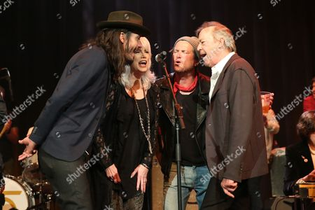 From left, artists Cory Chisel, Emmylou Harris, Butch Walker and Boz Scaggs perform at the Dylan Fest at Ryman Auditorium, in Nashville, Tenn
