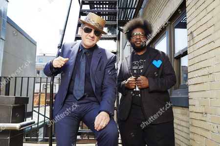 """From left, English singer-songwriter Elvis Costello poses for a portrait with drummer Ahmir """"Questlove"""" Thompson of """"The Roots"""", in promotion of their upcoming album """"Wise Up Ghost"""" on in New York"""