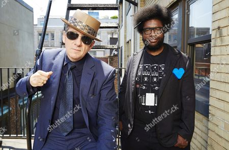 From left, English singer-songwriter Elvis Costello poses for a portrait with drummer Ahmir 'Questlove' Thompson of 'The Roots', in promotion of their upcoming album 'Wise Up Ghost' on in New York