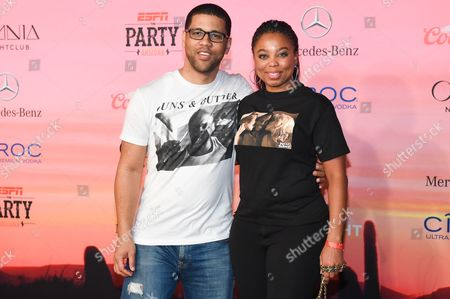 Michael Smith, left, and Jemele Hill attend the ESPN Super Bowl XLIX Party on in Scottsdale, Ariz