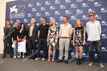 From left, jury members Emmanuel Carrere, Hou Hsiao Hsien, Lynne Ramsay, Alfonso Cuaron, Nuri Bilge Ceylan, Elizabeth Banks, Francesco Munzi, Diane Kruger and Pawel Pawlikowski pose for photographers at the photo call for the Jury at the 72nd edition of the Venice Film Festival in Venice, Italy, . The 72nd edition of the festival runs until Sept. 12