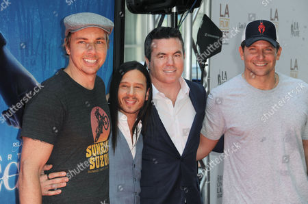 Dax Shepard, from left, Andrew Panay, Jason Gray-Stanford, and Bradley Cooper arrive at The Los Angeles Film Festival Earth to Echo Premiere at Regal Cinemas L.A. Live Stadium, in Los Angeles