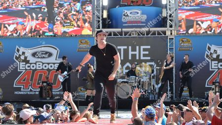 Reid Perry of The Band Perry performs prior to the Ford EcoBoost 400 at the Homestead Miami Speedway on in Homestead, Fla