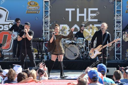 Neil, Kimberly and Reid Perry of The Band Perry perform prior to the Ford EcoBoost 400 at the Homestead Miami Speedway on in Homestead, Fla