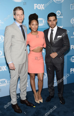 Stark Sands, from left, Meagan Good and Wilmer Valderrama arrive at the Fox Network 2015 Programming Upfront at Wollman Rink in Central Park, in New York