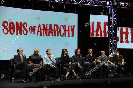 From left, creator Kurt Sutter, director Paris Barclay, Charlie Hunnam, Katey Sagal, Kim Coates, Theo Rossi, Dayton Callie and Drea de Matteo on stage during the Sons of Anarchy panel at the The FX 2014 Summer TCA held at the Beverly Hilton Hotel, in Beverly Hills, Calif
