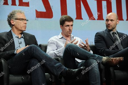 From left, showrunner Carlton Cuse, co-creator Chuck Hogan and Corey Stoll on stage during the The Strain panel at the The FX 2014 Summer TCA held at the Beverly Hilton Hotel, in Beverly Hills, Calif