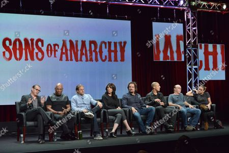 "From left, Creator Kurt Sutter, Director Paris Barclay, Charlie Hunnam, Katey Sagal, Kim Coates, Theo Rossi, Dayton Callie and Drea de Matteo speak on stage during the ""Sons of Anarchy"" panel at the The FX 2014 Summer TCA held at the Beverly Hilton Hotel, in Beverly Hills, Calif"
