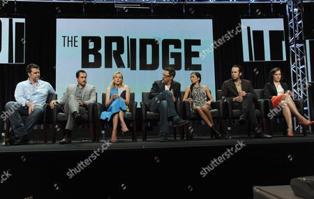 From left, Executive Producer Elwood Reid, Demian Bichir, Diane Kruger, Matthew Lilard, Emily Rios, Thomas M. Wright and Franka Potente speak on stage during the The Bridge panel at the The FX 2014 Summer TCA held at the Beverly Hilton Hotel, in Beverly Hills, Calif
