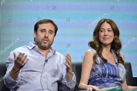 Co-creators Jeff Schaffer, left, and Jackie Marcus Schaffer speak on stage during the The League panel at the The FX 2014 Summer TCA held at the Beverly Hilton Hotel, in Beverly Hills, Calif