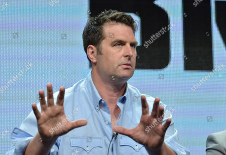 Stock Picture of Executive Producer Elwood Reid speaks on stage during the The Bridge panel at the The FX 2014 Summer TCA held at the Beverly Hilton Hotel, in Beverly Hills, Calif