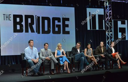 From left, Executive Producer Elwood Reid, Demian Bichir, Diane Kruger, Matthew Lillard, Emily Rios, Thomas M. Wright and Franka Potente speak on stage during The Bridge panel at the The FX 2014 Summer TCA held at the Beverly Hilton Hotel, in Beverly Hills, Calif