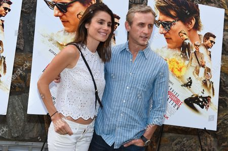 "Stock Picture of Dan Abrams, right, and Florinka Pesenti attend a special screening of ""Mission Impossible: Rogue Nation"" at the United Artists East Hampton Cinema 6, in East Hampton, NY"