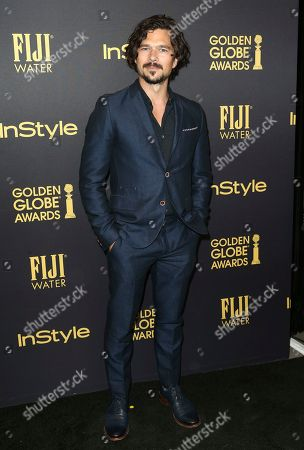 Luke Arnold arrives at the HFPA and InStyle celebration for the 2017 Golden Globe awards season at Catch LA, in West Hollywood, Calif