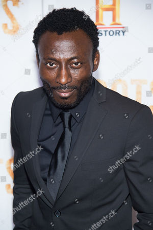 """Stock Picture of Babs Olusanmokun attends History Channel's """"Roots"""" mini-series premiere at Alice Tully Hall, in New York"""