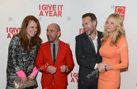 From left, Daisy Donovan, Dan Mazer, Rafe Spall, and Elize Du Toit seen at the European premiere of I Give It A Year at the Vue West End, in London
