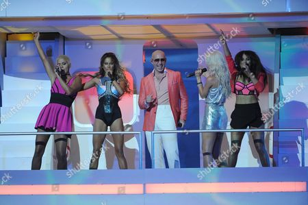 Pitbull and from left, Paula Van Oppen, Emmalyn Estrada, Lauren Bennett and Natasha Slayton, of G.R.L., perform at the iHeartRadio Music Awards at the Shrine Auditorium, in Los Angeles