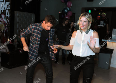 """The Bachelorette"""" winner Jef Holm, left, dances to Ubisoft's Just Dance 4 with party host Ashley Benson at the launch party on in Los Angeles.Just Dance 4 hits store shelves on Tuesday, Oct. 9, 2012"""