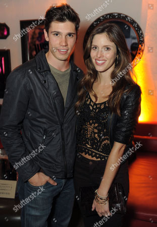 Kayla Ewell, right, and a guest attends the Just Dance 4 launch party hosted by Ashley Benson and Christina Milian on in Los Angeles. Just Dance 4 hits store shelves on Tuesday, Oct. 9, 2012.Â